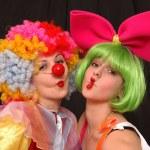 A portrait of two clown-girls in wigs...