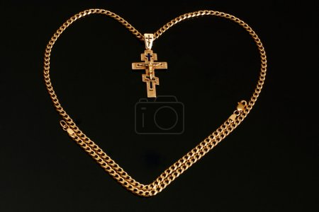 Gold chain with a cross and a crucifix