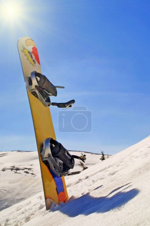 Snowboard on the mountain slop