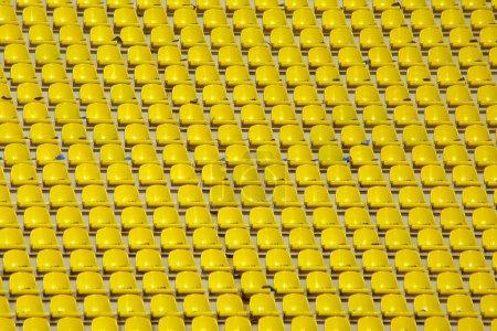 Yellow empty stadium seats