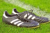 Football boots on a grass