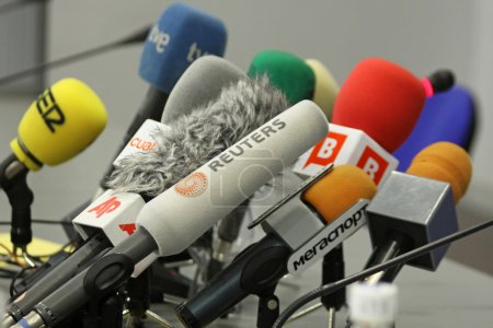 Photo for Microphones on a table during press-conference before UEFA Champions League football match between Dynamo Kyiv and FC Barcelona - Royalty Free Image