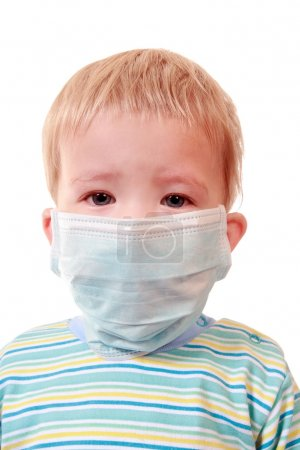 Two-years kid in a medical mask