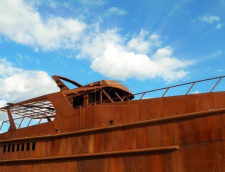 Rusty Boat on blue sky