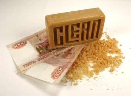 Photo pour Le crime Blanchiment d'argent avec du savon, isolé - image libre de droit