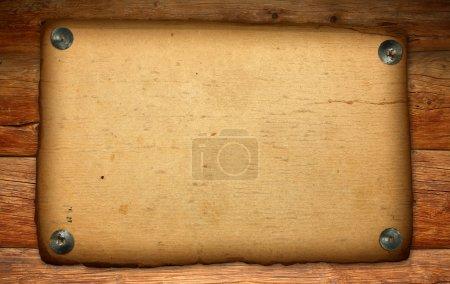 Old paper on antique wood backdrop