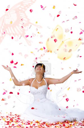Cute bride throws rose petals and butter