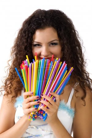 Photo for Cute young woman hold a lot of colorful straws. Studio shot - Royalty Free Image