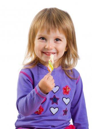 Pretty little girl with lollipop