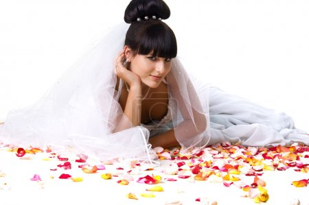 Beautiful bride with rose petals