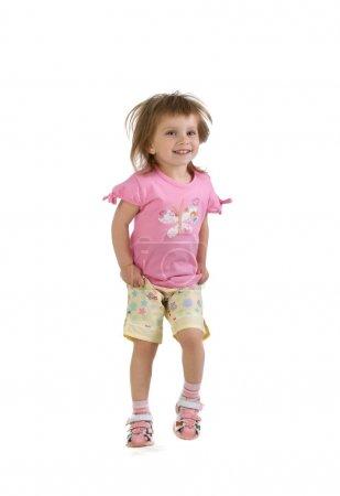 Cute little girl jumps