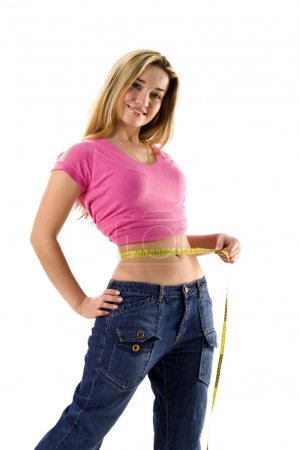 Pretty woman measuring her small waist