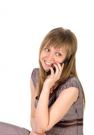 Woman listens on a mobile phone