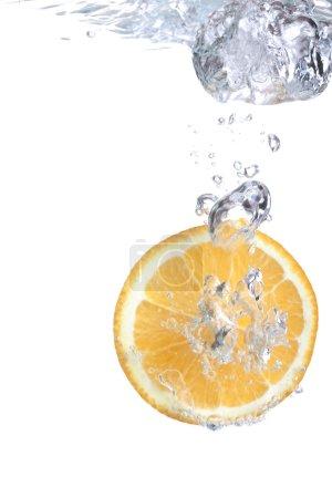 Orange falls into water