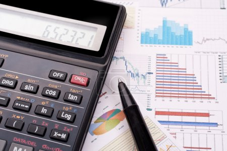 Photo for Financial statement with calculator and pen - Royalty Free Image