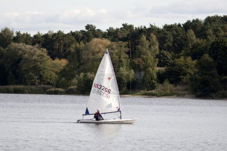 Sailboat on the forest lake