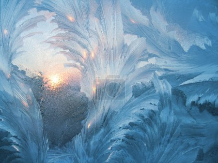 Photo for Frosty natural pattern and sun on winter window - Royalty Free Image