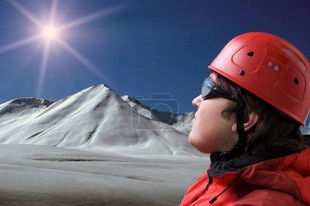 Rock-climber examines way on the top