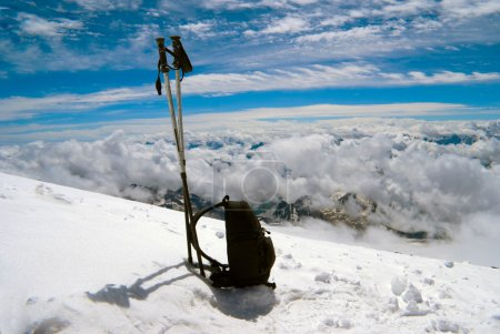 Ski poles and backpack cost on to snow