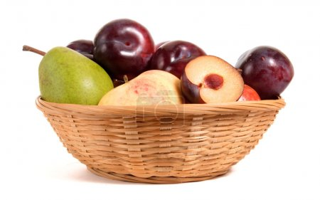 Photo for Fruits in basket isolated on white - Royalty Free Image