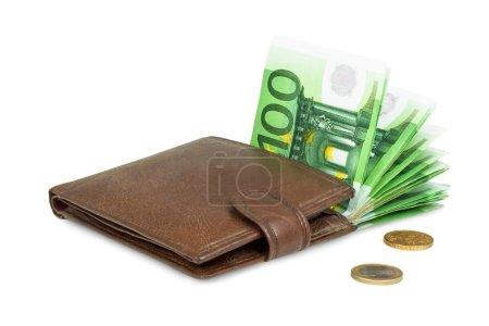 Photo pour Argent en portefeuille brun isolé sur fond blanc - image libre de droit