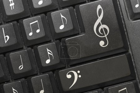 Photo for The keyboard of a computer with notes... - Royalty Free Image