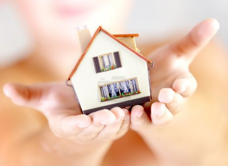 Photo for The house in human hands - Royalty Free Image
