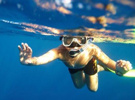 Photo for Boy floats under water in the sea - Royalty Free Image
