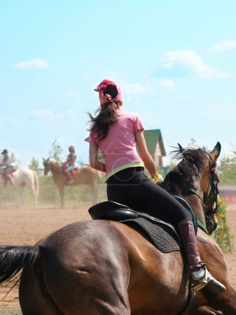 The girl skips on a horse...