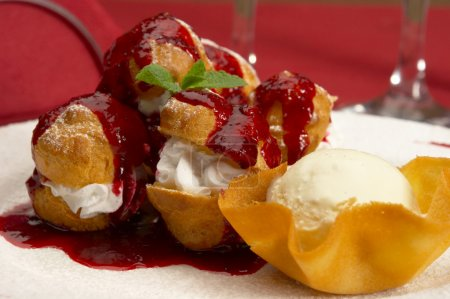 Photo for Tasty profiteroles on a dining table... - Royalty Free Image