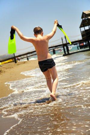 Boy goes along seacoast