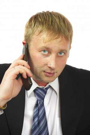 The businessman speaks by phone. Conduct