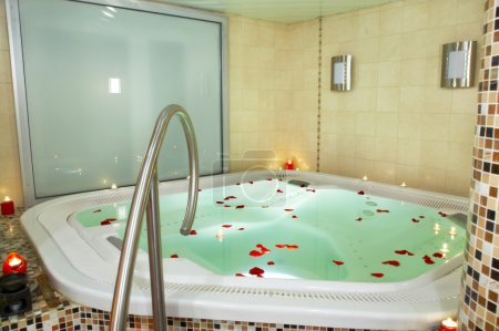 Photo for Bath of a jacuzzi with petals of roses - Royalty Free Image