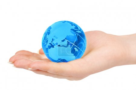Hand of the person holds globe