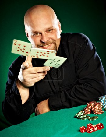 Photo for Man with a beard plays poker... - Royalty Free Image