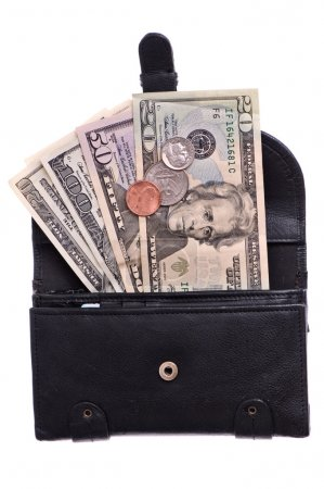Photo for Black leather purse with dollars and coins - Royalty Free Image