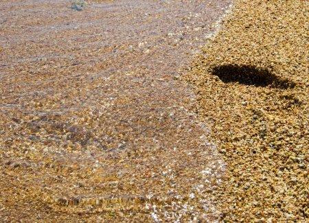 Photo pour Empreinte sur le sable - image libre de droit