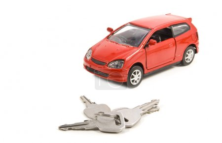 Keys and car isolated on white