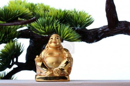 Photo pour Budai ou hotei - Dieu des richesses, il est populairement connu aussi comme le Bouddha fat. - image libre de droit