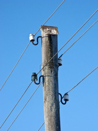 Old wooden electric pillar
