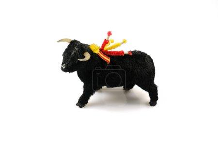 Toy black corrida ox isolated on white