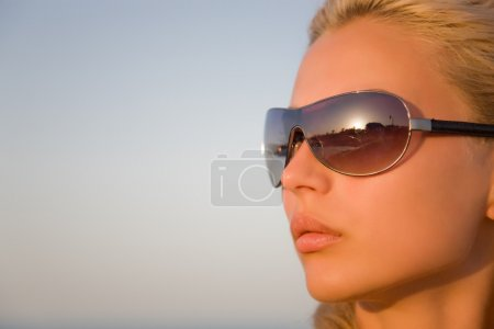 Girl with black glasses isolated on a bl
