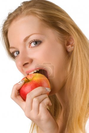 Photo for Portrait of the girl eating apple on white background, isolated - Royalty Free Image