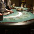 Modern and beautiful casino interior, focus of poker playing tables