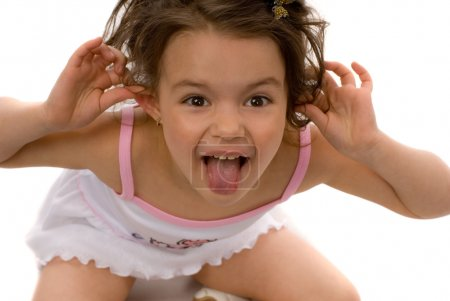 Photo for Little girl loll and stick to the ears of her hands - Royalty Free Image