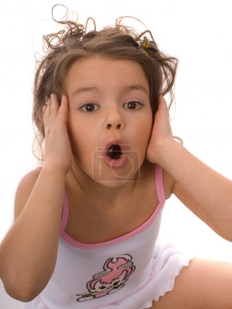 Photo for Little girl sitting on the floor with an open mouth - Royalty Free Image