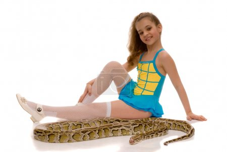 Photo for Young girl with royal python snake lying by her feet, isolated on white background - Royalty Free Image