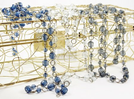 Blue, colorless and grey glassbeads