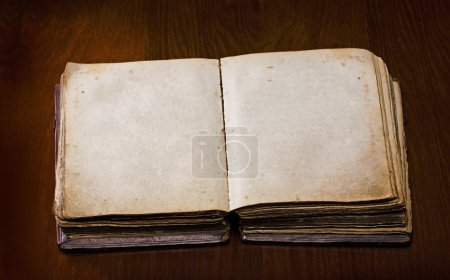 Photo for Old book with blanked pages over a wooden table - Royalty Free Image
