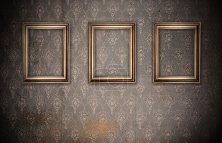 Three vintage frames on dirty wall